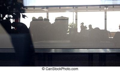 people rushing around the airport terminal