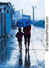 People rushing on the rainy street