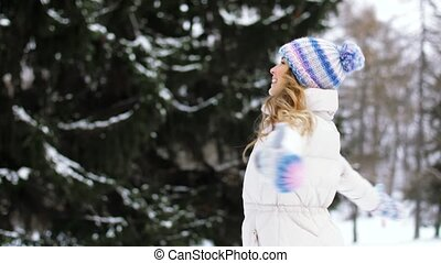 happy young woman in winter forest