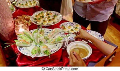 People Serve Themselves from Buffet Table in Hotel Restaurant