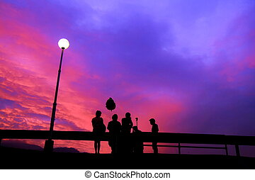 people shadow with sunset sky