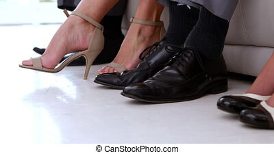 Business people shaking feet nervously waiting for interview in the office