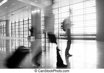 people silhouette in hall of office building
