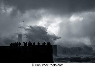 People silhouette looking at a sea storm
