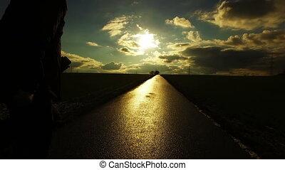 People Silhouette on Road in Field