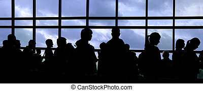 People silhouette - People waiting in line at the airport...