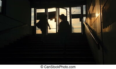 People silhouettes in underground passage