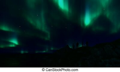 People silhouettes northern lights. Nordic nature landscape ...