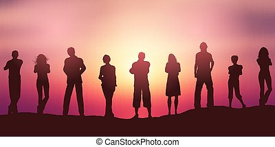 People silhouettes social distancing against a sunset sky