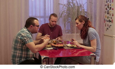 People sit at the table and dinner