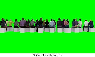 People sit on chairs with their backs to the camera on a ...