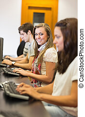 People sitting at the computer smiling