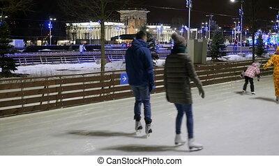 People skate on the rink skating winter