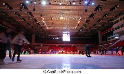 people skating in skating rink with illumination