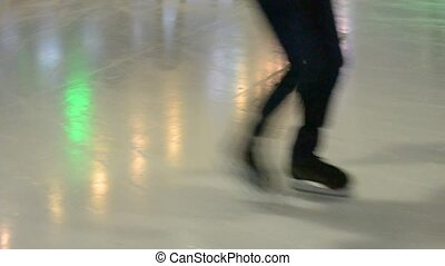Unidentifiable people skating on ice skating rink