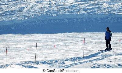 People Ski And Snowboard Past