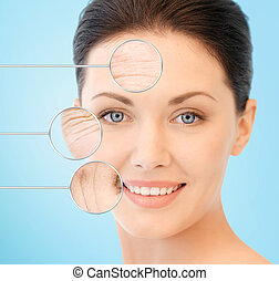 face of beautiful happy young woman - people, skin care and...
