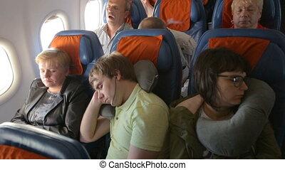 People sleeping in the airplane
