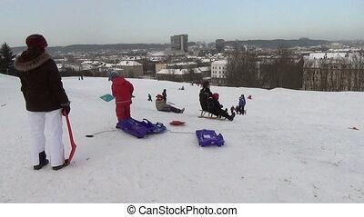 people slide hill winter
