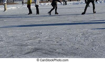 people slide lake winter