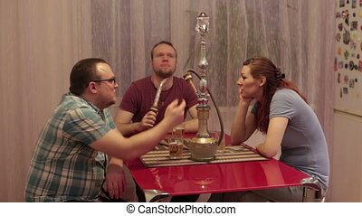 People smoke shisha and talking