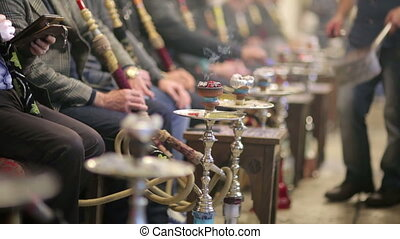 People smoking shisha at Nargile Cafe, Istanbul - People...
