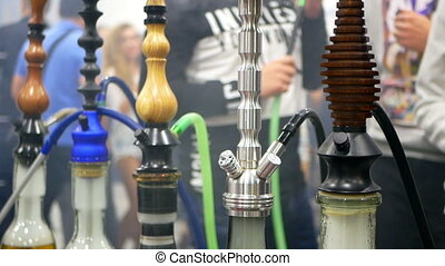 People smoking shisha cafe - People smoking shisha at cafe,...
