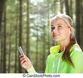 happy woman with smartphone and earphones - people, sport, ...