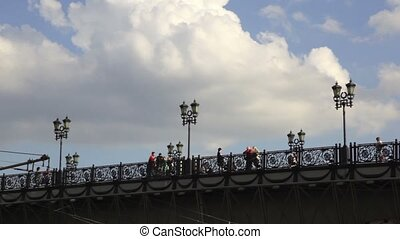 People stand and walk on bridge near Christ The Saviour Cathedral