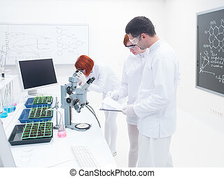 people studying in a chemistry lab - side view of a...