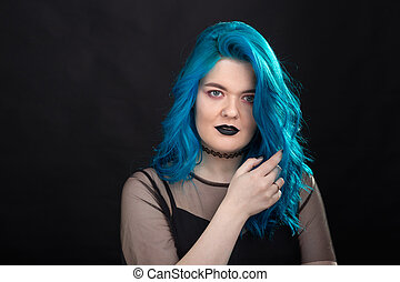 People, style and fashion concept - Close up portrait of young woman with blue long hair dressed in black dress