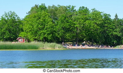 """people swimming scandinavian waters near stockholm,..."