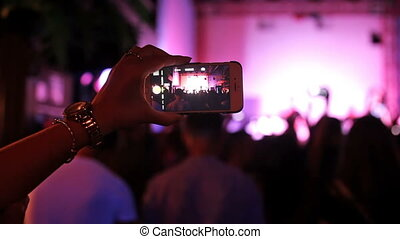 People take off concert on a mobile phone