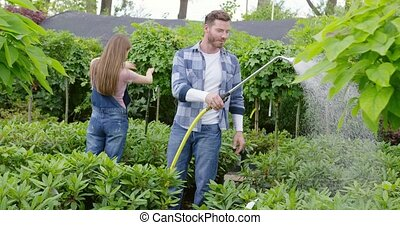 People taking care of flowers in the garden