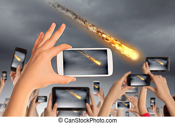 People taking photo of meteorite - Close up of human hands...