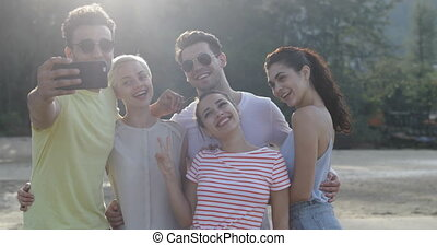 People Taking Selfie Photo Together On Beach, Young Friends Group Posing Outdoors Natural Light