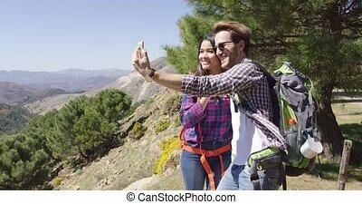 People taking selfie while hiking