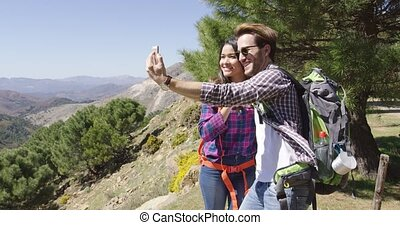 People taking selfie while hiking
