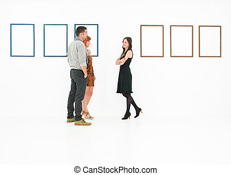people talking in a museum