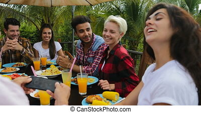People Talking Sitting At Table Outdoors Eating On Terrace...