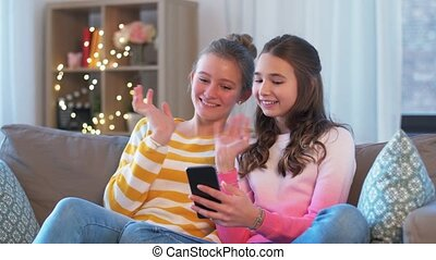 teenage girls with smartphone having video chat
