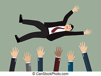 People throw a businessman in the air