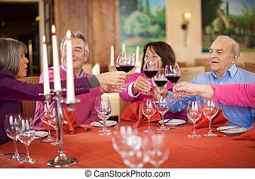 People Toasting Wine Glasses At Restaurant