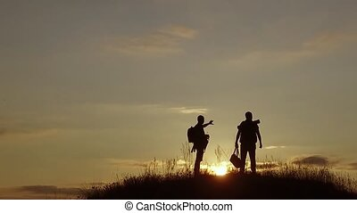 people tourists. people group of tourists walking on top nature of a travel sunset silhouette mountain. slow video tourists people group go