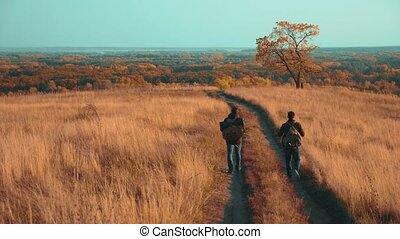 people tourists travel in nature the autumn adventure. slow...