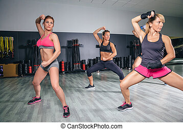 People training boxing in a fitness center - Group of people...