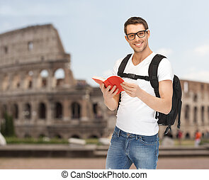 happy young man with backpack and book travelling - people, ...