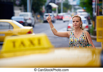people travelling-business woman stopping yellow taxi -...