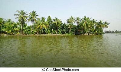 People travelling in water cab in Kerala Backwaters