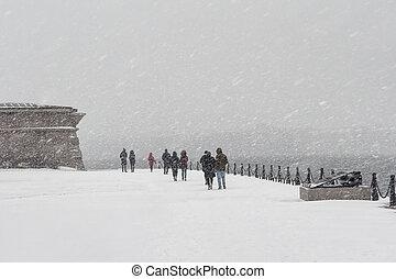 People under the snow in St. Petersburg.